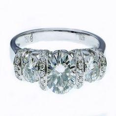Diamond Moissanite Engagment Ring 18 ct White Gold. A beautiful Moissanite Engagement or Dress Ring, Featuring 3 large Brilliant Cut sparkling Gems.