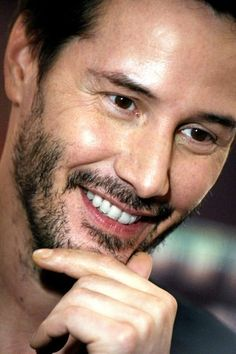 Keanu Reeves/.....What a charming smile! We don't get to see it very often. He's such a somber guy most of the time.