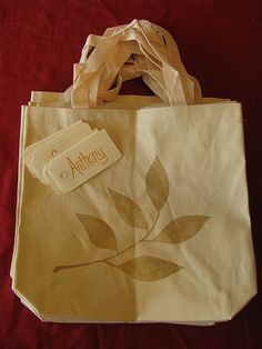 Stenciled tote bags as Christmas gift bags.