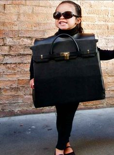 Cover your cardboard box with pleather and create the cutest baby Birkin bag ever.   33 Super Easy Cardboard Box Halloween Costumes For Lazy People