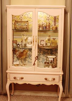 I'm smitten with this jewelry display cabinet.  She shares how she made it.