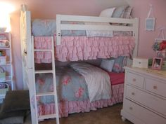 Found bunk beds on CL for $400.  Bedding is from Targets Simply Shabby Chic line.  I found the bedskirt online for about $55.  It was originally a king size and white.  I hand dyed it with latex paint, cut it to fit the sides and hot glued it on.