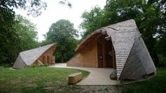 Ecotourism Center in France: The orientation of the structures ensures protection from the main winds and the eco friendly energies sources used. The use of wood and its implementation permits eco-construction solutions. Superficial foundations insure the project's reversibility without significant damage to the land. #ecotourism
