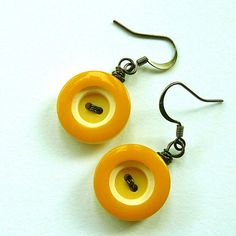 Mustard button earrings, would be awesome with different sized earrings