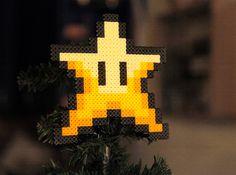 Retro Christmas Star Tree Topper Super Mario Bros Inspired. €18.00, via Etsy.