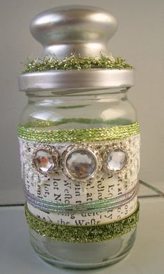 Jar decorated with book pages and more - I did a wine bottle in a similar style. Looks nice.