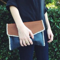 Parcel & Journey perforated leather clutch modeled and photographed here by Alex Yeske, dreams + jeans. #fashionforgood #streetstyle #clutch