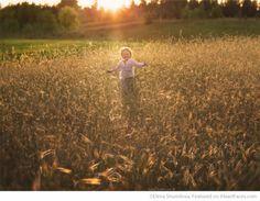 Boy running in rye field - Photo by Elena Shumilova - I Heart Faces Photographer Spotlight Series