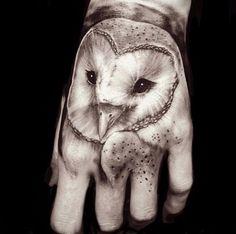 Barn owl tattoo on hand by Greg Sumii