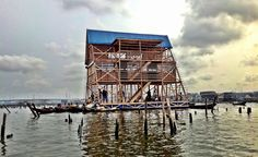 Built for the coastal water community of Makoko, the structure draws on local vernacular and units raised on stilts