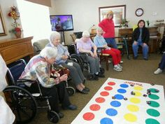 Beanbag Twister Toss. Have residents spin to determine the color the beanbag toss must land on. There are variations of this game. Can have circles identifying random objects or places of interest. The residents attempt to get the correct answer by landing near or on the correct circle.   Credit: https://www.pinterest.com/pin/50243352066136314/  the pin feature failed to locate thru the URL.
