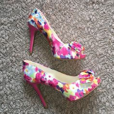 NWT Spring Floral Silky Cute Fioni Heels w/ Bow 6 new with tags! never worn. size 6. colors pink, blue, purple, green, orange, yellow, & white. silky material. cute bow on each heel. Super cute! Perfect for spring & summer. Fioni Shoes Heels
