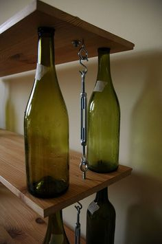 bookshelves...pretty nifty use for all those leftover wine bottles: