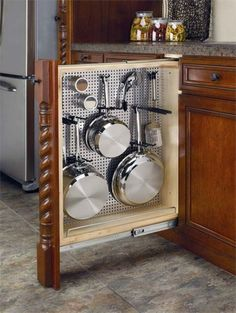 A vertical drawer with a place to hang pots and pans!
