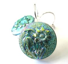 EVERYONE SHOULD WEAR GLASS EARRINGS! The light dances off of them! Vintage glass button earrings with floral design by SewSandyShop, $24.00