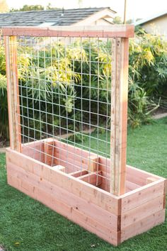 Incorporating a trellis into your garden is a great way to take advantage of unused space. See how we built this raised planter bed with a built in trellis. Planter Box With Trellis, Raised Planter Beds, Garden Planter Boxes, Diy Trellis, Diy Planters, Raised Garden Beds, Raised Beds, Diy Garden Box, Vegetable Planter Boxes
