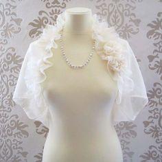 MOZEE Light Cream Ruffle Mohair Rosette Romantic Bridal Short Sleeve Bolero/Shrug. $58.00, via Etsy.