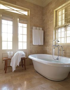 Traditional Southern Interior Design by Ty Larkins - House Beautiful travertine tiles floor to ceiling