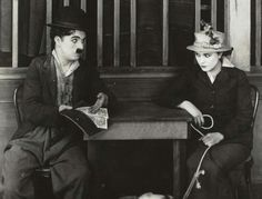 "Edna Purviance & Charlie Chaplin in ""A Dog's Life""."