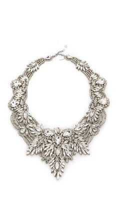 A sparkling Jenny Packham bib necklace offers a nod to vintage style with nature-inspired designs and sinuous curves. The crystals are affixed to a double-layered organza backing to create a lightweig