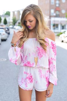 I don't like her lip color at all, but the romper is super cute