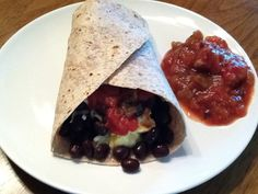 Cheesy Bean Burrito: Down the center of a low-carb whole grain wrap (about 50 cals), layer scrambled eggs (1 whole+2 whites), 2 TB shredded reduced-fat cheese, ½ cup rinsed/drained black beans, & a dollop of salsa. Then fold up bottom & roll up the sides. This burrito delivers a healthy mix of protein and carbs, plus a huge dose of fiber: 315 cals, 30g protein, 12g fiber. And it's absolutely delicious!