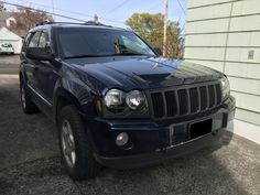 """Stillen Headlight Accents; Blacked-out Headlight Assembly; Black Painted Grille (Duplicolor Primer; Matte Black; VHT Matte Clear Coat); 1.25"""" Wheel Spacers on stock Ronnin II 245/65R17; 2005 Jeep Grand Cherokee 5.7 Hemi"""