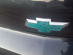 This is a HUGE HIT!!!!! Repinned over and over and over!!!!!!        Blinged the chevy bowties. Companies charge  $280-$350 per emblem. I\'m crafty and smart. Both emblems blinged for under $10