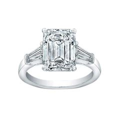 Emerald cut engagement rings never loose that classic art deco feel.  This ring is from Norman Silverman.