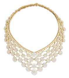 """A DIAMOND AND GOLD """"SNOWFLAKE"""" NECKLACE, BY VAN CLEEF & ARPELS"""