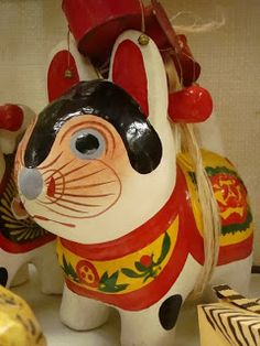 j2009/Japan toy museum: vintage regional folk toys including kokeshi dolls, daruma figures, paper fish and a plaster dog.