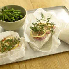 A great idea for a summer barbecue. So simple to prepare - and no washing up afterwards! The fish takes on the fragrance of the lemon, herbs and onion yet retains its simplicity and freshness.
