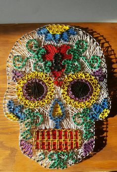Hey, I found this really awesome Etsy listing https://www.etsy.com/listing/483334907/sugar-skull-string-art-sugar-skull-home