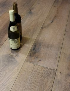 School House 220 aged wide plank oak engineered flooring is a bespoke plank length oak floor that has been naturally aged and hand worked to enhance the natural rustic character of each plank. It is then and coated in a tough matt finish wax oil and the beveled edges are stained to enhance the aged look of this floor. The tough natural oiled finish is long lasting and adds to the floors historic feel. The generous 20mm thickness makes for a reassuringly heavy plank and the thick 6mm oak top…
