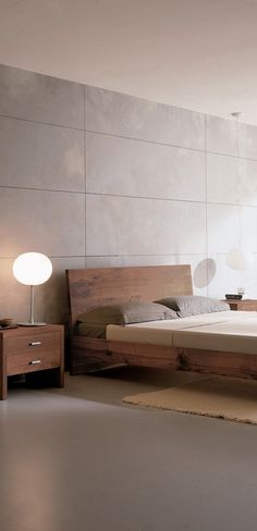 Modern bedroom with simple light fixtures to compliment the simple bed and tables