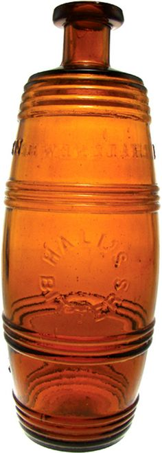 Hall's Bitters, Barrel, Amber A Hall's Bitters glass barrel bitters bottle in amber