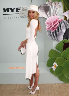 Jennifer Hawkins wearing Alex Perry and millinery by Ann Shoebridge poses at the Myer Marquee on Derby Day at Flemington Racecourse on October 31, 2015 in Melbourne, Australia.