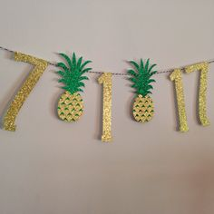 The 5.5 inch tall numbers in this banner are cut from extra sparkly gold glitter card stock. The pineapples are also 5.5 inches tall. The date is strung on black and white twine. At the comment section at check out, please include: -the date for the banner -number color and twine color (black, white, gold, b/w twine) (it will be made as pictured if color choices are not included) -date the banner is needed by  Please see my shop announcement and shipping policies for current production t...