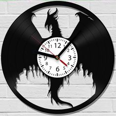 Hey, I found this really awesome Etsy listing at https://www.etsy.com/listing/269483736/dragon-age-wall-clock-from-old-vinyl
