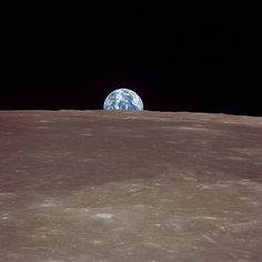 This image taken July 20, 1969 from NASA's Apollo 11 lunar landing mission shows the Earth rising over the limb of the moon. Credit: NASA