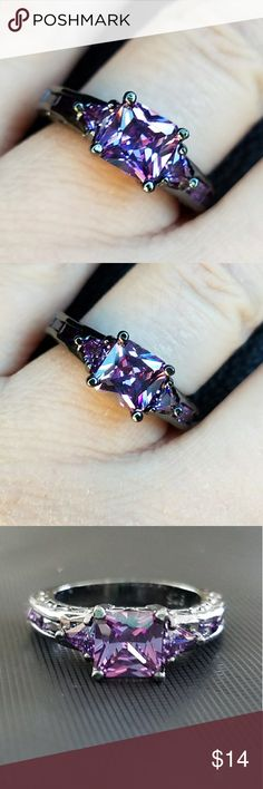 New Purple cubic zirconia black gold plated ring This is a brand new black gold plated ring. It has a square purple cubic zirconia for the main stone. There are smaller purple stones on the side of the ring. Jewelry Rings
