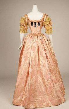 """Ball gown (rear view) Jacques Doucet (French, Paris 1853–1929 Paris) Date: 1897 Culture: French Medium: silk Dimensions: a) CF: 50 1/2""""; CB: 56 1/4""""; Waist: 22 1/2""""; Width at bottom: 3 1/3 yds. b) CF: 41 1/4""""; CB: 44""""; Waist: 23 1/2""""; Width at bottom: 2 1/2"""" Credit Line: Gift of Orme Wilson and R. Thornton Wilson, in memory of their mother, Mrs. Caroline Schermerhorn Astor Wilson, 1949 Accession Number: 49.3.26a, b"""