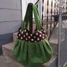 Global Girlfriend Wool and Satin Handbag Green, brown with white polka dots.  Magnetic closure.  Wool straps.  4 large silver grommets.  Lined with coordinating brown satin.  Handmade in Vietnam by women's artisan group.  Pocket for phone and large zippered pocket inside. Like new. Global Girlfriend Bags Shoulder Bags