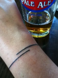 Wrist tattoo. Just a line. A super cool looking line. A bracelet tattoo.