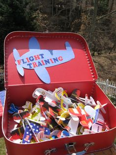 Paper airplanes in an old suitcase- Flight training. Make runway and see who can fly their plane; how far, tricks, how high, etc.