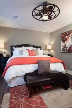 Grey, black and white bedroom with coral accent