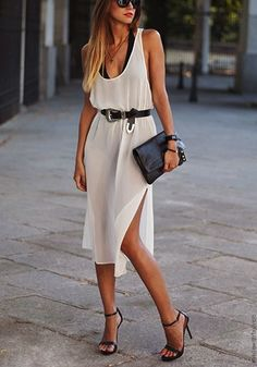 Sleek white high split dress & cinched in belted waist