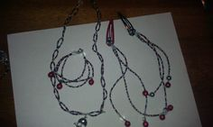 red bells with black, red, and silver beads.,