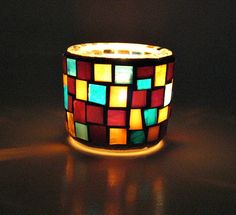Stained glass mosaic tealight candle holder brown amber and turquoise. $12.00, via Etsy.