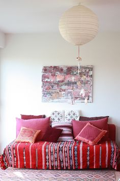 love the textile over the sofa trick